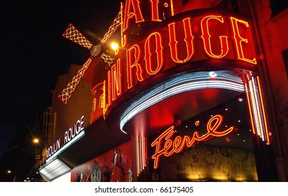PARIS FRANCE - JULY 24: The Moulin Rouge by night July 24, 2009 in Paris, France. Moulin Rouge is a famous cabaret built in 1889, locating in the Paris red-light district of Pigalle