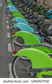 PARIS, FRANCE – JULY 26, 2019: Parking for public hire bikes and electric bikes. High Resolution Image.