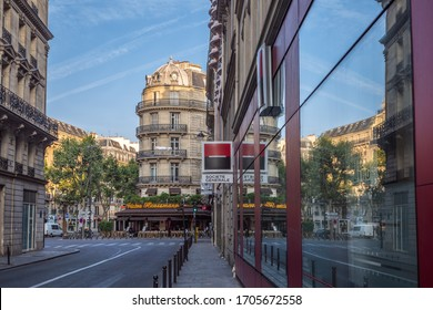 PARIS, FRANCE – JULY 27, 2014: An early sunny summer morning in the historic center of Paris.