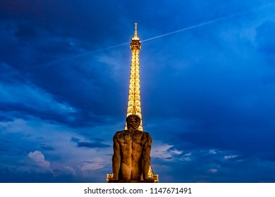 PARIS, FRANCE- JULY 27, 2018: Trocadero park sculpture of a naked man in front of the Eiffel tower in Paris