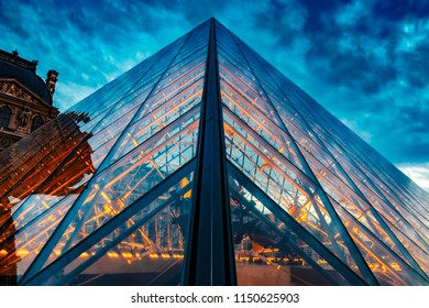 PARIS, FRANCE- JULY 27, 2018:  Close up of the Louvre glass roof at sunset.