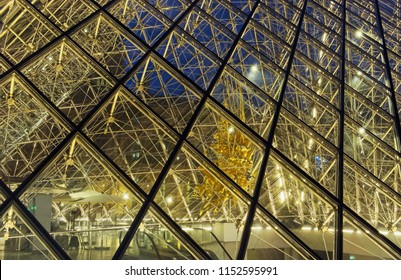 PARIS, FRANCE- JULY 27, 2018:  Close up of the Louvre glass roof with interior lighted.