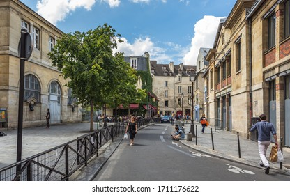 PARIS, FRANCE – JULY 28, 2014: Summer morning on the streets in the Marais district at the walls of the famous Halle des Blancs Manteaux in the old Parisian Covered market, built in 1813.