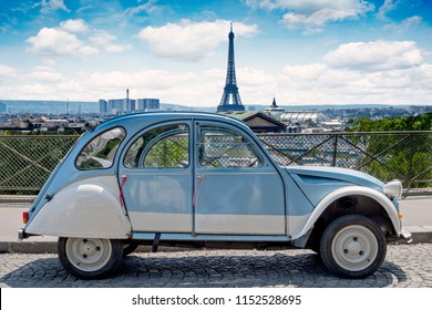 PARIS, FRANCE - JULY 28, 2018: Historic Citroen 2 CV car standing in front of the Paris cityscape. Citroen 2 CV represents the Paris lifestyle like no other object in France.