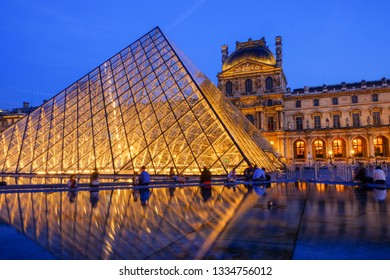 PARIS, FRANCE - July 3, 2016: Dusk at the Glass Pyramid, Louvre Museum
