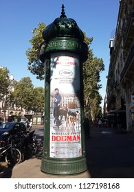 PARIS, FRANCE - JULY 3, 2018: Iconic advertisign cylindrical column known also as Morris column features advertisement for a movie on July 3, 2018 in Paris, France.