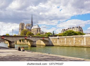 PARIS, FRANCE - JULY 30, 2015: Notre-Dame de Paris in summer seen across the Seine