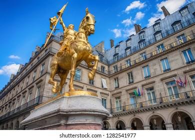 "PARIS, FRANCE - JULY 31, 2013: Statue of Jeanne d'Arc (Jeanne d'Arc) in Paris, France. Jeanne d'Arc, ""The Maid of Orleans"", the folk heroine of France and the Roman Catholic saint"