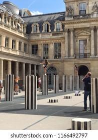 PARIS, FRANCE - July 31, 2018: Palais-Royal (Palais-Cardinal, 1639) personal residence of Cardinal Richelieu in Paris. Columns Buren (1985) - favorite place of photography for tourists
