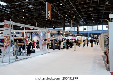 PARIS, FRANCE - JULY 5, 2014: People visit stands at Mode City, a swimwear and lingerie tradeshow where over 20,000 buyers meet 500 exhibitors from 35 different countries.