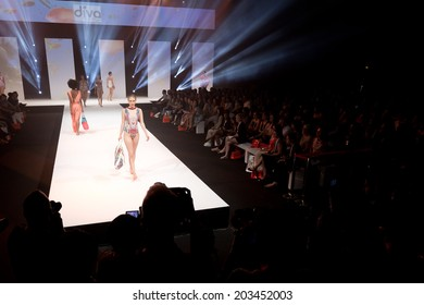 PARIS, FRANCE - JULY 5, 2014: Models walk the runway at Mode City, a swimwear and lingerie tradeshow where over 20,000 buyers meet 500 exhibitors from 35 different countries.