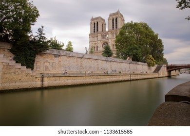 Paris, France - July 5, 2018: Notre Dame de Paris and Cite island captured from the opposite bank of Seine river