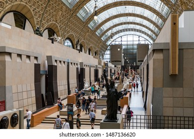Paris, France - July 5, 2018: Visitors at the Musee d'Orsay in Paris. Located in the former Gare d'Orsay train station, the museum has the largest collection of impressionist paintings in the world.