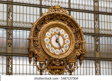 Paris, France - July 5, 2018: Golden clock of the museum D'Orsay. The Musee d'Orsay is a museum in Paris, on the left bank of the Seine. Golden colored clock inside Musee d'Orsay Museum in Paris.