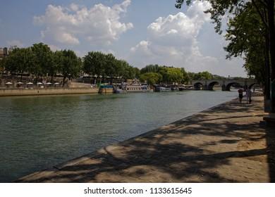 Paris, France - July 7, 2018: River seine with bridge in Paris