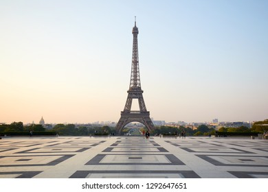 PARIS, FRANCE - JULY 7, 2018: Eiffel tower and people at sunrise, clear sky in Paris, France