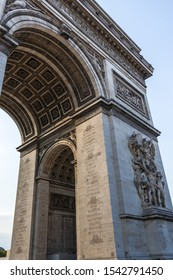Paris, France - July 7, 2018: A fragment of the south facade of  the Arc de Triomphe de l'Étoile with the Le Départ de 1792 (or La Marseillaise) sculpture group and engravings on the pillar