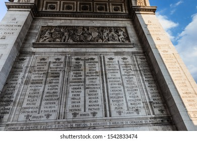 Paris, France - July 7, 2018: The inner facade of the south pillar with the engraved names of the military leaders of the French Revolution and Empire. The Arc de Triomphe de l'Étoile