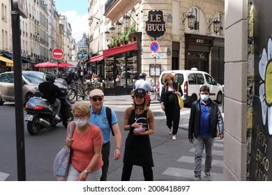 Paris, France - July 7 2021:  Tourists in Quartier Latin close to Odéon.