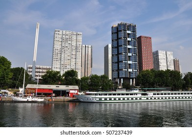 PARIS, FRANCE - JULY2: The Novotel Paris Tour Eiffel hotel and boat hotel on July 2, 2015 in Paris, France. Novotel is a modern hotel is overlooking the Seine river.