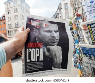 PARIS, FRANCE - JUN 12, 2017: Man point of view personal perspective buying at press kiosk  French newspaper Liberation with portrait of Emmanuel Macron after French legislative election, 2017