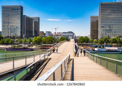 Paris, France. Jun 29th, 2018. Passerelle Simone de Beauvoir is the footbridge between Parc de Bercy and François-Mitterrand Library over the River Seine in Paris.