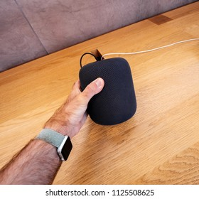 PARIS, FRANCE - JUN 30, 2018: POV holding in Apple Store the latest Apple Computers HomePod smart speaker developed computer firm