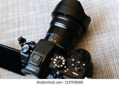 PARIS, FRANCE - JUN 30, 2018: Side view of new Panasonic Lumix DMC-GH5 and newest Leica Vario-Elmarit 8-18 Micro Four Thirds System digital still mirrorless video camera