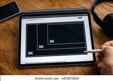 Paris, France - Jun 6, 2019: Man reading on Apple iPad Pro tablet about latest announcement showing the Pro Display XDR 6k resolution compare with 4k and 5k