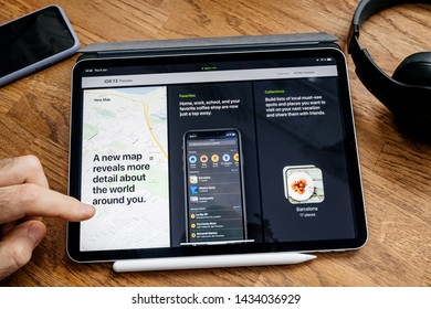 Paris, France - Jun 6, 2019: Man reading on Apple iPad Pro tablet about latest announcement of at Apple Worldwide Developers Conference (WWDC) - showing the IOS 13 preview with maps app