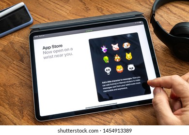 Paris, France - Jun 6, 2019: Man reading on Apple iPad Pro tablet about latest announcement of at Apple Worldwide Developers Conference WWDC - showing the appstore on Apple Watch