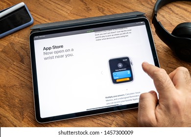 Paris, France - Jun 6, 2019: Man reading on Apple iPad Pro tablet about latest announcement of at Apple Worldwide Developers Conference - showing the Calculator, voice recorder and memo app on watch
