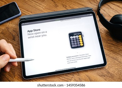 Paris, France - Jun 6, 2019: Man reading on Apple iPad Pro tablet about latest announcement of at Apple Worldwide Developers Conference WWDC - showing the calculator app on watch