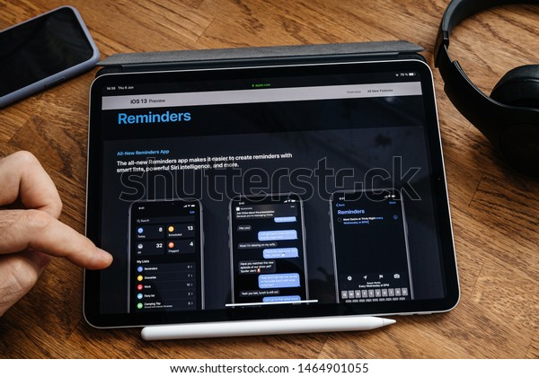Paris, France - Jun 6, 2019: Man reading on Apple iPad Pro tablet about latest announcement of at Apple Worldwide Developers Conference showing the iOS 13 feature all-new reminder app