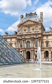 PARIS, FRANCE, JUNE 03, 2018: Famous Paris Louvre. Fragment of Louvre Museum with Louvre Pyramid.
