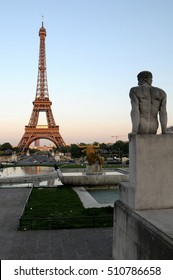 PARIS, FRANCE - JUNE 05, 2008: Sculptures on Trocadero and Eiffel Tower view at dusk