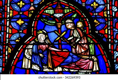 PARIS, FRANCE -  JUNE 1, 2015 Queen Jerusalem Medieval Life Stained Glass Saint Chapelle Paris France.  St King Louis 9th created Chapelle and stained glass with Bible Medieval stories in 1248.
