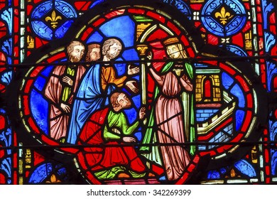 PARIS, FRANCE -  JUNE 1, 2015 Queen With Followers Medieval Life Stained Glass Saint Chapelle Paris France.  St King Louis 9th created Chapelle and stained glass with Bible Medieval stories in 1248.