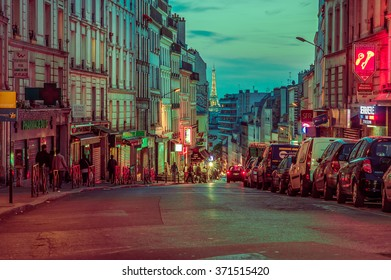 Paris, France June 1, 2015: Cozy and beautiful walking through historic city streets with incredible charm and beautiful architecture, vivid streets