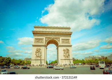 Paris, France - June 1, 2015: Spectacular view magnificent monument Arch of triumph, as seen from close range on a beautiful sunny day