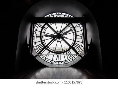 "Paris, France - June 1, 2018 : the famous glass clock in the dark room of ""Musée d'Orsay"" in Paris"