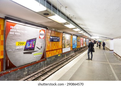 PARIS , FRANCE- JUNE 10, 2015: Tourists and locals on a subway train station in Paris, France. More than 30 million people visit Paris annually.