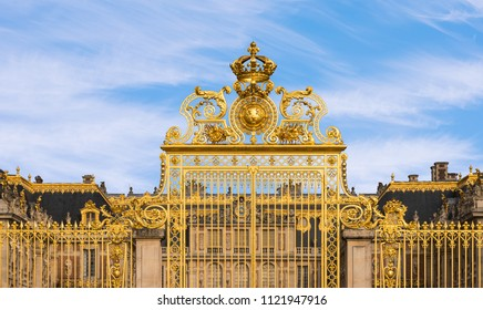 PARIS, FRANCE -  June 10, 2018: Front golden gate of Famous Palace Versailles. The Palace was the principal residence of the Kings of France from Louis XIV in 1682 until the French Revolution.