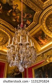 PARIS, FRANCE -  June 10, 2018: Crystal ceiling chandelier in the Palace Versailles. The Palace was the principal residence of the Kings of France from Louis XIV in 1682 until the French Revolution.