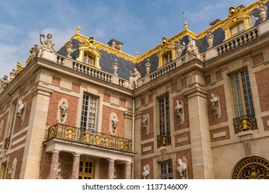 PARIS, FRANCE -  June 10, 2018: Architecture and gold adorned buildings of Palace Versailles. It was the principal residence of the Kings of France from Louis XIV in 1682 until the French Revolution.