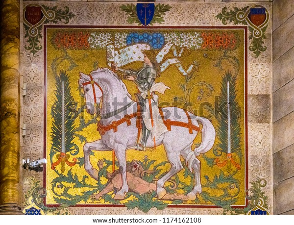 Paris, France - June 10, 2018: A mosaic wall decoration of Joan of Arc in the Basilica of the Sacred Heart of Paris (Sacré-Cœur Basilica).