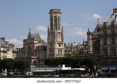 Paris, France - June 11, 2015: The Saint-Germain l'Auxerrois church located in Paris, France. Tourists are also boarding the STIF public transportation.