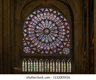 PARIS, FRANCE - June 11, 2018: Interior stained glass windows of famous historic Notre Dame Cathedral in Paris.