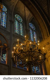 PARIS, FRANCE - June 11, 2018: Interior stained glass windows and chandelier of famous historic Notre Dame Cathedral in Paris.