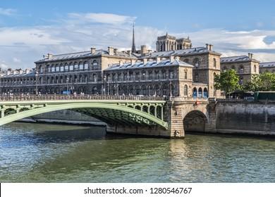 PARIS, FRANCE - JUNE 12, 2018: View of Pont Notre-Dame (1914) - bridge that crosses Seine in Paris and linking Quai de Gesvres on Right Bank with Quai de la Corse on Ile de la Cite.